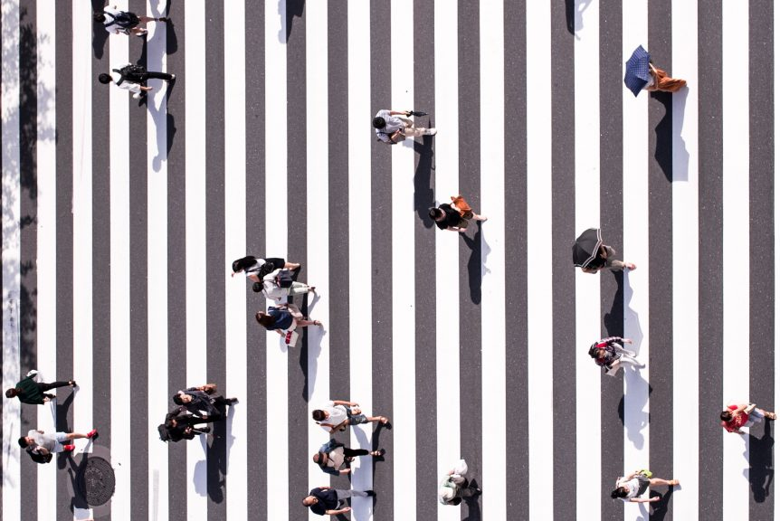 people crossing a city street